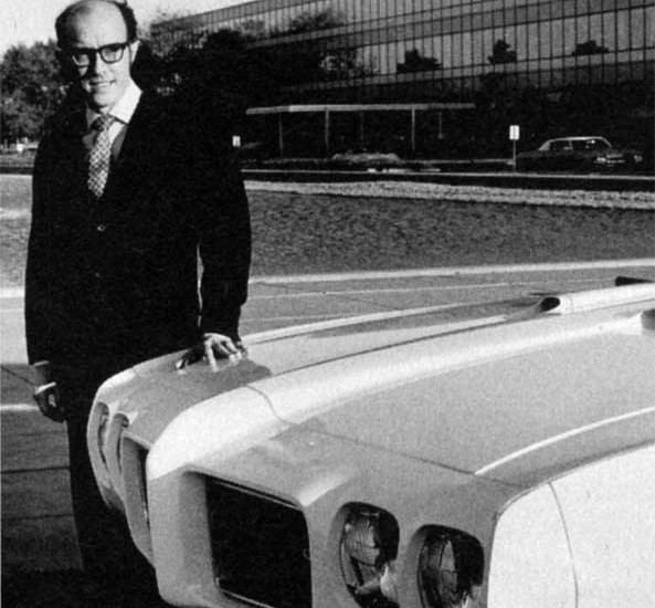 Pontiac Chief Designer Bill Porter poses proudly with a 1970 GTO in front of GM Design Staff at the GM Tech Center.